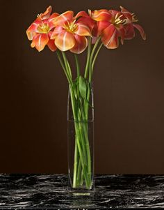 Too cool! Transform common tulips by folding back each petal. Great centerpiece idea. | countryliving.com