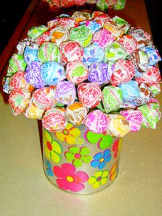 I made these for my daughters 1st birthday party and used them as centerpieces... Have also added personalized wrappers on both the dumdums and the can. I used empty formula cans for the base!