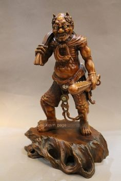 large Japanese oni figure with a club and sack