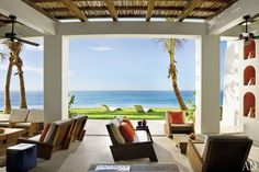 The architecture firm Ike Kligerman Barkley used outdoor rooms to extend a house in Cabo San Lucas, Mexico, into the surrounding landscape. This veranda offers panoramic views over the infinity pool to the ocean beyond. From Architectural Digest.