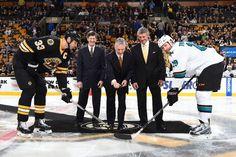 San Jose Sharks forward Joe Thornton and Boston Bruins defenseman Zdeno Chara take the ceremonial faceoff (Oct. 21, 2014).