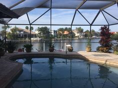 in Merritt Island, US. A private Master Bedroom Suite with views and access to the screened pool and the water beyond. The luxurious bath has a jacuzzi tub and multiple-head shower. We have a screened solar heated pool.  Prepare and enjoy meals with a view, morning coff...