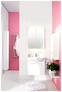 Pink accent walls in this cute bathroom