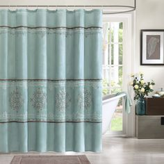 Give your bathroom a more traditional look with the Madison Park Brussel shower curtain. Its beautiful polyoni blue base is enhanced with chocolate brown medallion embroidery.