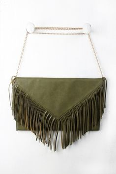 "Pointed Fringe Flap Envelope Bag. Description This vegan leather envelope  bag  features a v-shape pointed flap with fringe trim, magnetic button closure, and a zippered main compartment. Includes a detachable curb link chain shoulder strap with a 25"" drop.  Measurement Measures approx. 9.8"" L x 14.9"" W x 1.0"" D"