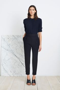 Maintain a sleek silhouette with Apiece Apart's Palace Tapered Trouser in Black. This high-waisted trouser with front pleats feature a narrow, tapered leg, with an invisible zipper at the inner ankle, Business Outfits, Business Attire, Office Outfits, Casual Outfits, Fashion Outfits, Business Casual, Office Fashion, Work Fashion, Trouser Outfits
