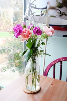 flowers milk bottle vase