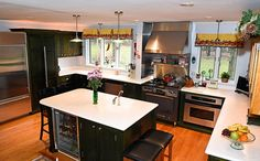 Gourmet kitchen with three sinks, sub zero fridge, pantry, wine cooler, chef's oven/stove and convection oven