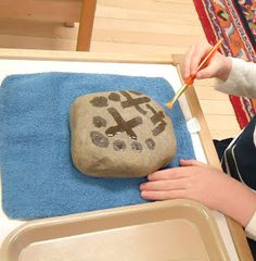 "To the Lesson!: ""Peace Is In Our Hands"" A beautiful job for the Peace shelf. painting with water onto stones would be a good intro to painting for the nursery"