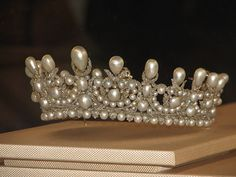 The pearl  diamond diadem made by Gabriel Lemonnier for Empress Eugénie. It was set with 212 drop-shaped and round pearls weighting 2,520 metric grams  1998 tiny brilliants weighting 63.3 metric carats. It was once accompanied by a matching coronet. Happily the diadem, which was part of the collection sold at auction 1887, was preserved by the princely family of Thurn und Tanis,  was purchased by the Louvre when it was offered for sale at Sotheby's in Geneva on 17 November 1992.