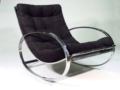 Milo Baughman Chrome rocking chair.  Simple, minimalist, and easy on the spine....
