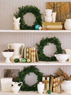 Wreaths on Shelves: To make a simple holiday wreath, wrap green florist's wire around the ends of boxwood clippings to form five or six small bunches. Wrap the bunches around a wreath base with more wire so that they overlap. Use the wreaths to decorate shelves and punctuate with jewel-toned ornaments or other trinkets.