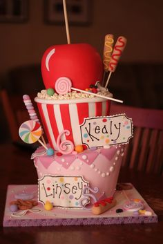 Delightful! fair food carnival cake pop corn candy corndogs- perfect cake goes with what I love about this theme. Both kids names would fit!