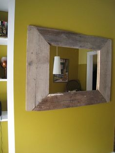Cool mirror made with reclaimed wood.