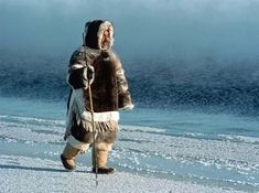 Inuit man dressed in traditional clothing. The Inuits made all clothing from seal fur.