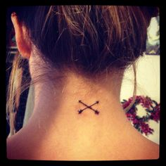Crossed arrows on the back of the neck tattoo. Would like this better if it was a single arrow