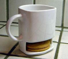 Coffee cup with cookie port.