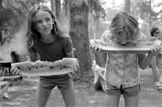 Girls competing in a watermelon eating contest on July 4th in White Springs, Florida, 1983.