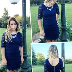 Navy lace dress Ezra Navy lace dress with scalloped hem and on sleeves.  NWOT.  Beautiful navy color, photo doesn't do it justice! Ezra Dresses