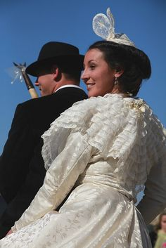 A traditional wedding in Arles, Provence. After getting married by the mayor Hervé Schiavetti at the city hall, Elodie Borelly is brought on a white horse to the Mayor Church, dressed with the traditional costume of Arlésienne. After the catholic ceremony, the groom, Victor Mailhan, takes the bride away also on his horse.