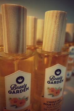 L'huile bio aux fleurs de calendula et son emballage éco-conçu.  Flacon en verre recyclé et recyclable et bouchon en bois labellisé PEFC ! Une raison de + pour l'adopter ! #eco-conception #madeinfrance #bois #BeautyGarden