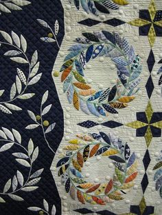 I love the blue wreaths and the navy border on this one.. Tokyo International Great Quilt festival 2009