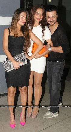 Sanjay was photographed with actress Amrita Arora, who looked splendid in an LBD and a pair of neon pink pumps.