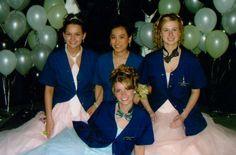 Mindee, Linda, Dani, and Aliese pose in their work smocks during their Senior Prom.