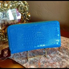 Sky Blue Wallet/TGIF Price!  This double compartment wallet features a wrist strap and has several credit card slots. Lined interior. Gold Tone zipper closure. (This closet does not trade or use PayPal) Son Paises Bags Wallets