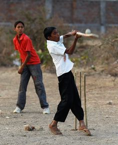 Street Cricket In Nagpur.  Local children play cricket on February 24, 2011 in Nagpur, India.