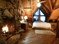 Third-floor master bedroom with king-sized bed, fireplace and amazing views.