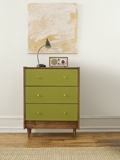 Olive paint, walnut stain, and brass knobs give a flat-pack dresser mid-century modern flair in our One Piece, Five Ways series