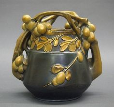"""A turn of the century Amphora/Tepliz type earthenware vase, in the manner of Paul Daschel. Art Nouveau design with Olive tree form, in a Green/Gold mottled glaze. Impressed marks """"Made In Austria"""