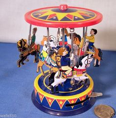 Brand New Repro CARNIVAL CAROUSEL TIN LITHOGRAPH Six Horse Ride Retro Toy