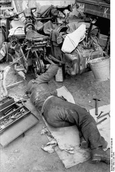 German soldier repairing a sidecar. Russia July 1941