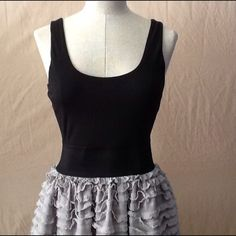 Tiered ruffle bottom tank dress NWOT tiered ruffle bottom dress from Miley Cyrus/Max Azria. Very simple but cute tank dress. Middle has wide bandage and the rest is soft knit fabric. Miley Cyrus/Max Azria Dresses