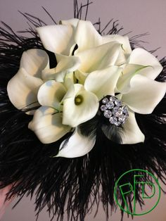 ostrich feathers and calla lilies. #wedding