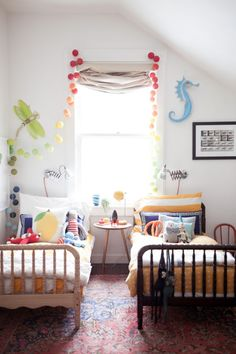 2 Jenny Lind toddler beds in small bedroom. paint walls white and bring in color through decorative items.