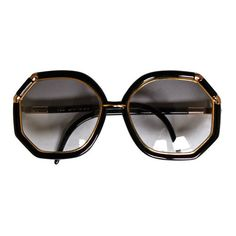 TED LAPIDUS - 1970's TED LAPIDUS black and gold oversized sunglasses ❤ liked on Polyvore