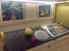The Octonauts HQ, complete with Ikea lap top trays, bottle tops, and stick on frames with push button light