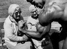 Arnold Schwarzenegger shows off to some elderly women in the 1970's.  http://dailylifestyle.com/rare-never-seen-photos-of-the-past/27/