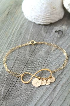 Gold Jewelry Personalized Mother Mom gold filled Infinity bracelet - While the bond between the two is almost unbreakable, the number of simple gold necklace designs can almost make a woman swoon over her spreading desire Cute Jewelry, Gold Jewelry, Jewelery, Jewelry Accessories, Jewelry Design, Handmade Accessories, Jewelry Ideas, Bracelet Infinity, Gold Necklace Simple