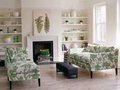Living Room Designs: Leafy Green    Patterned upholstery, ceramics and glass vases feel fresh in a green and white palette.