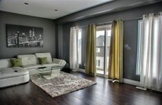 a simple dark hard wood floor, light wall color and great furniture from J-D Decor.