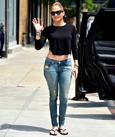 Work that crop top! Jennifer Lopez shows off her famous figure while walking through NYC.