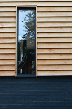 modern timber cladding and dark painted brick - love love love mix of dark painted brick with coordinating windows and cladding Wood Cladding Exterior, Larch Cladding, House Cladding, Wood Facade, Cladding Ideas, Aluminium Cladding, Exterior Signage, Exterior Stairs, House Siding
