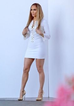 Jennifer Lopez great legs in a short lace up front little white dress and gold high heels Sexy Jennifer Lopez Legs, Jennifer Lopez Photos, Sexy Legs And Heels, Sexy High Heels, Great Legs, Beautiful Legs, Sexy Dresses, Short Dresses, Short Skirts