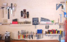 Wall Tool Holders by Matthias Wandel -- This project offers a neat alternative to hanging tools from a pegboard. These holders are made of wood and are each custom-sized for the intended tool. http://www.homemadetools.net/homemade-wall-tool-holders
