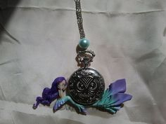 Mermaid with clock in fimo polymer clay by Artmary2 on Etsy, €28.00