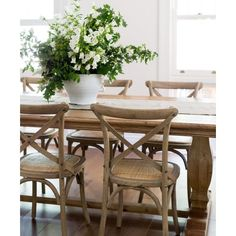 <p><span>Our oak cross back chairs feature timeless French…